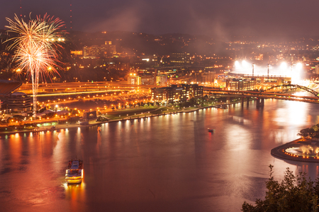 Night view of Pittsburgh North Shore during celebrations with fireworks