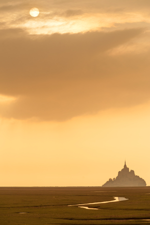 mount saint michael: Silhouette of famous Mont Saint Michel on Normandy coast at sunset, France Stock Photo