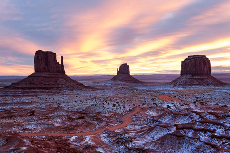 Sunset over snow covered Monument Valley Navajo tribal park, Arizona