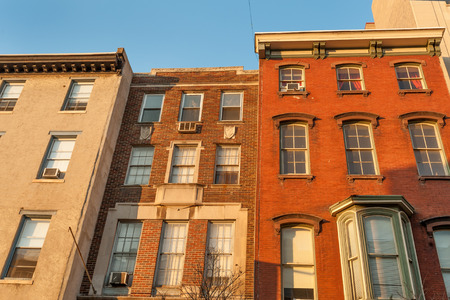 typical: Colorful old townhouses on historic Chestnut street in Philadelphia Center City Stock Photo