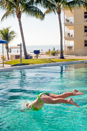 Jumping into the pool of beachfront condo in Fort Meyers, Florida