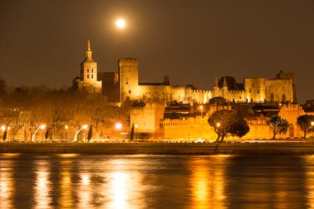 Nighttime panorama of historic Avignon with rising moon, Provence Stock Photo