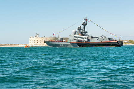 SEVASTOPOL, CRIMEA - MAY 9: Parade of the Russian warships celebrating Victory Day on May 9th, 2015. Russian Navy Tarantul class corvette Breeze in the Sevastopol Bay, Crimea Editorial