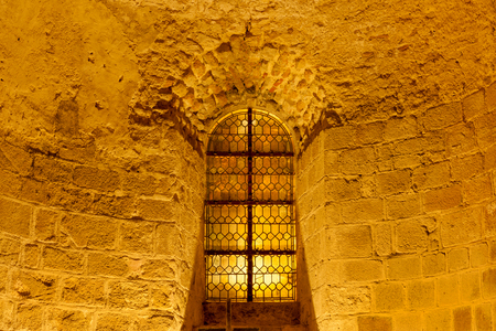 Window on the corridor wall inside Mont Saint-Michel abbey, Normandy coast, France Stock Photo