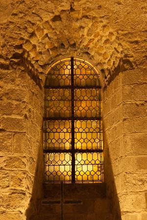 Window on the corridor wall inside Mont Saint-Michel abbey, Normandy coast, France Archivio Fotografico