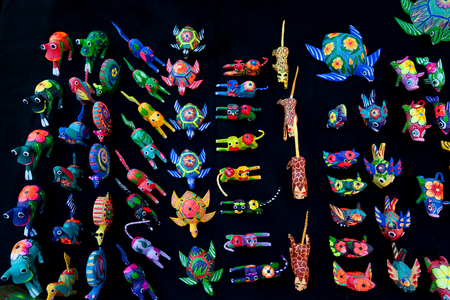 Alabrije, traditional Mexican colorful wooden toys on the market stall, Santa Fe, New Mexico, USA