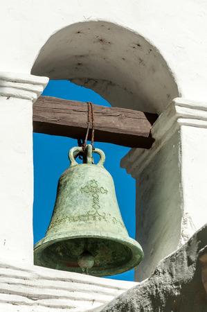 Close up of bronze bell on Spanish mission Basilica San Diego de Alcala belltower, California, USA Фото со стока