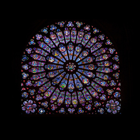 Rose window stained glass of famous Notre Dame de Paris cathedral in Paris, France