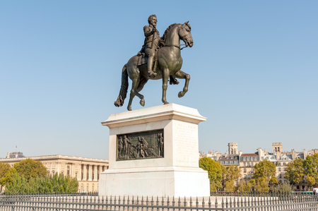 Bronze equestrian statue of king Henry IV on Pont Neuf, the oldest standing bridge in downtown Paris, France