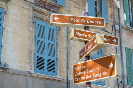 Historic city center of Avignon with directions to tourist attractions, Provence, France