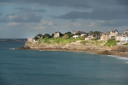 Panorama of Dinard, famous holiday destination on Breton coastline,  with Saint-Malo in the distance, Brittany, France