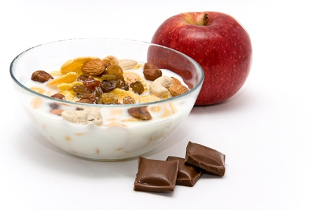 muesli with chocolate and apple isolated on white background photo