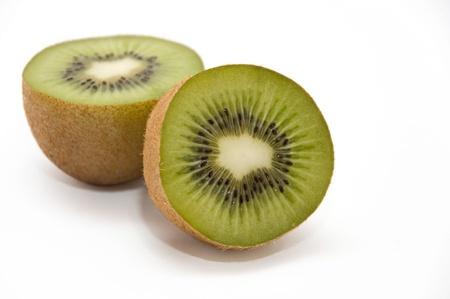 two halves of kiwi isolated on white background Stock Photo - 9325748