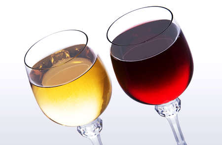 two glasses with red and white wine on light background