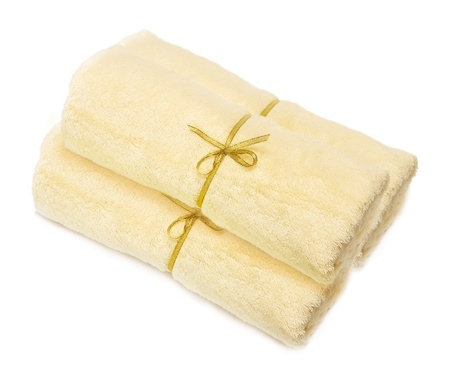 pile a light yellow towels isolated on a white background Stock Photo - 9349517
