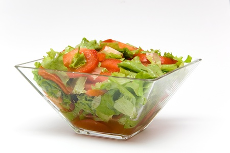 Fresh salad from lettuce and tomatoes isolated on white background photo