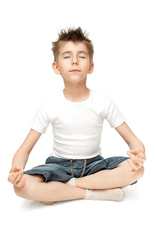 Relaxed child practicing yoga isolated on white background Stock Photo - 9434432