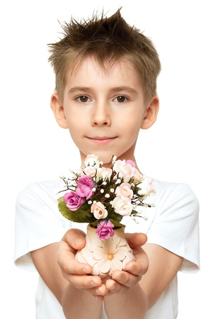 Little boy with bouquet of flowers on white background photo