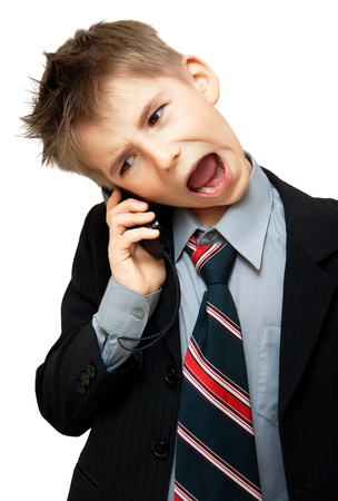 Boy In Suit Yelling Into Cellphone over white background Stock Photo - 9444344