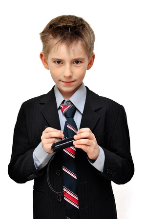 Boy In Suit wrote an  message on the cell phone over white background photo