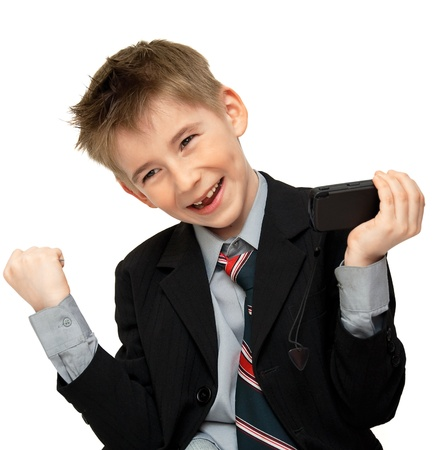 joyful boy in a suit with a cell phone photo