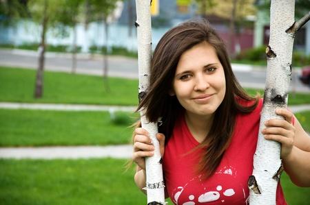 stuartkey: portrait of teen girl in a park near a tree