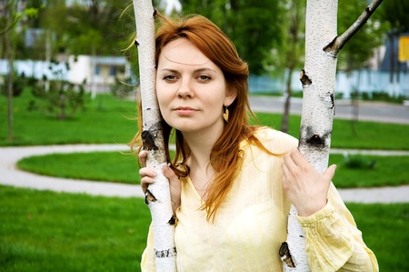 stuartkey: portrait of young women in a park near a tree