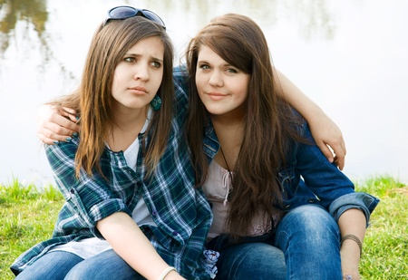 Two young teens by the lake photo