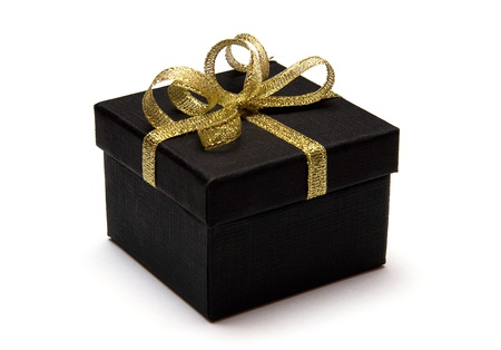 black gift box with gold ribbon isolated on white background photo