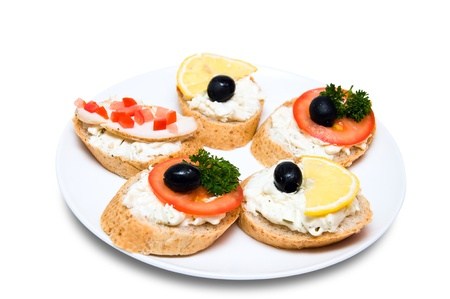 mini candwiches with cheese, vegetables, chicken, lemon and olives on white plate Stock Photo - 9565104