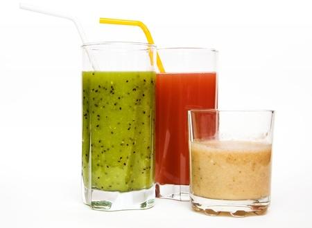 banana, strawberry and kiwi fresh juice in glasses isolated on white background Stock Photo - 9565099
