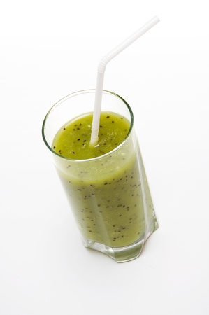 slurp: Healthy kiwi smoothie in glass  on light background