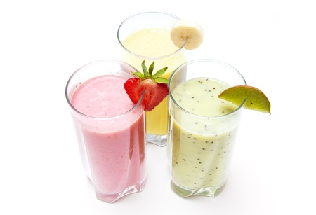 Strawberry, banana and kiwi smoothies isolated on a white background