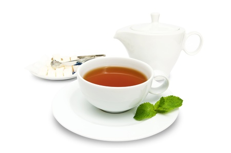 Cup of tea with mint leaves, teapot  and sugar isolated on a white background Stock Photo