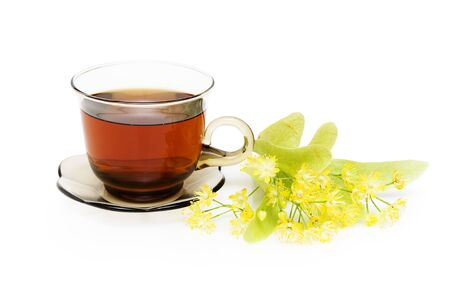 Herbal tea with Linden in glass cup over white background photo