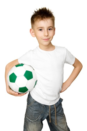 kids football: Boy with soccer ball a over white background