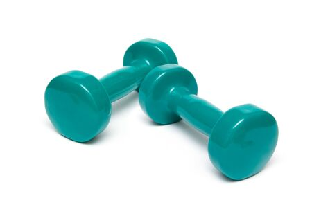 Free Weights green Dumbells isolated on a white background