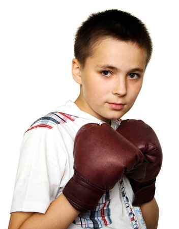 Young boy wearing brown boxing gloves