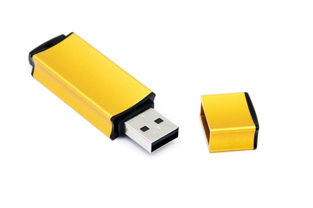 Golden USB Memory Stick isolated on a white background Stock Photo - 9718542