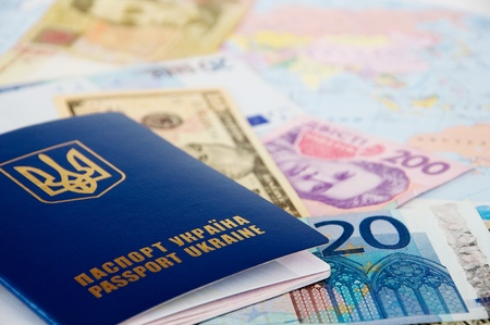 passport and money from different countries are on the world map photo