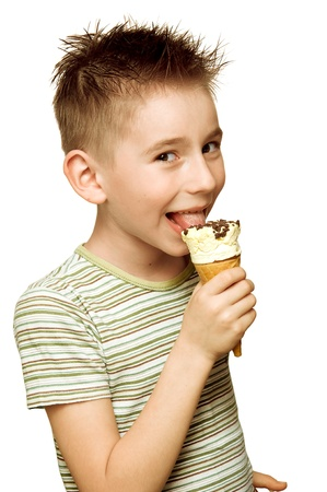 Eighth year boy eating ice cream isolated on white