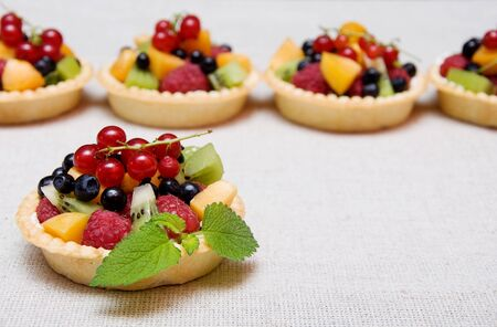 Sweet fruit dessert with raspberries, apricot, kiwi and blueberries in tartl Stock Photo - 9870606