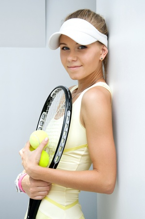 portrait of a beautiful girl with a tennis racket photo