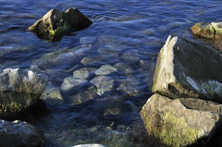 ashore: Big rocks in the water. Abstract background.