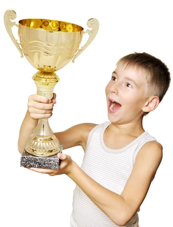 victory stand: Portrait of an excited little champion with his trophy isolated against white background