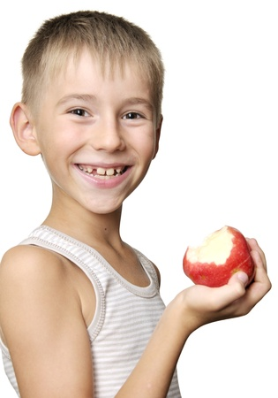 cute boy eating red apple isolated on a white background photo