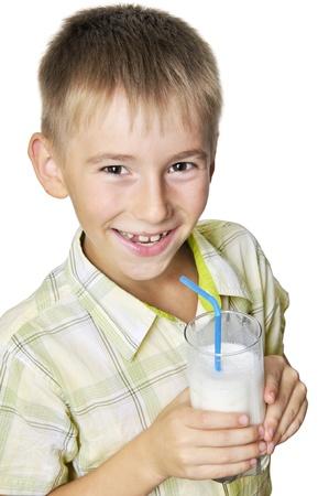 smiling boy drinking milkshake over white background photo