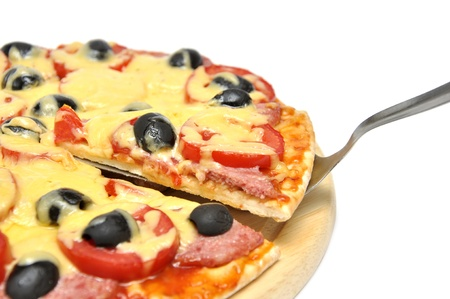 slice-lifted pizza with olives, tomato and salami Stock Photo - 10696361