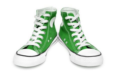 Pair of new green sneakers isolated on white background
