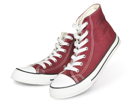 スニーカー: 白い背景上に分離されて新しい赤いスニーカーのペア